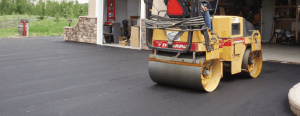 Calgary paving truck finishing a driveway, driveway and acreages paving residential