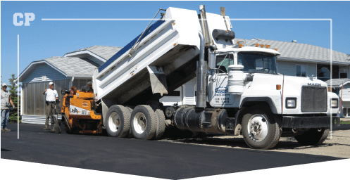 White dump truck loading an asphalt paver, work done by Calgary paving, asphalt resurfacing, asphalt resurfacing cost, asphalt resurfacing products